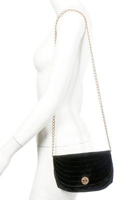 Lot 10 - A Chanel quilted black velvet evening bag, 1980s