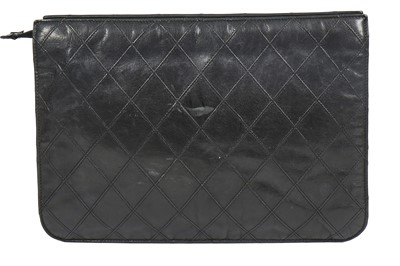 Lot 13 - A Chanel quilted black lambskin leather pochette, 1986-88