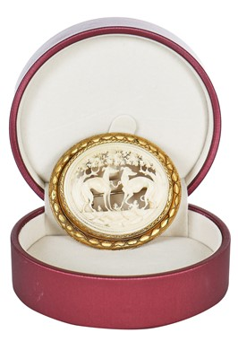 Lot 30 - A finely-carved ivory brooch set in a gilt mount, probably French, 1860s-80s