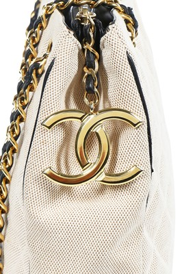Lot 1 - A Chanel quilted canvas and navy lambskin leather bag, Spring-Summer 1991 ready-to-wear