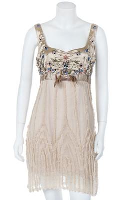 Lot 51 - A John Galliano pale-peach ruffled chiffon baby-doll-style dress, circa 2008