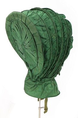 Lot 488-A green silk caleche bonnet, early 19th century,...