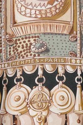 Lot 92 - An Hermès reversible printed silk and wool...