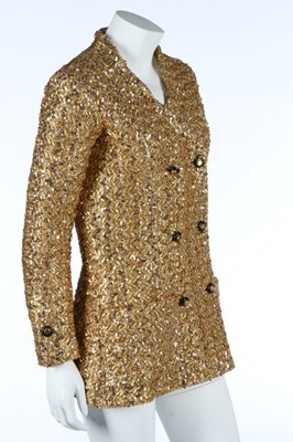 Lot 232 - A Chanel couture gold lurex-weave jacket, 1969,...